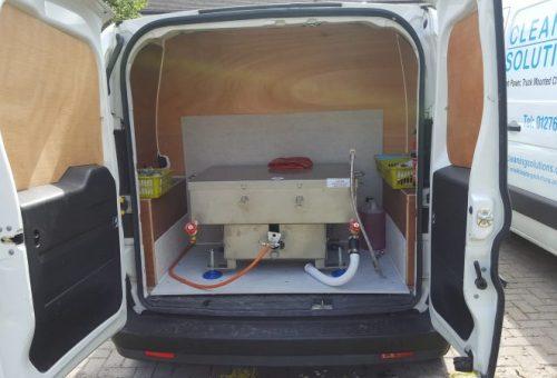 Oven cleaning tank in van
